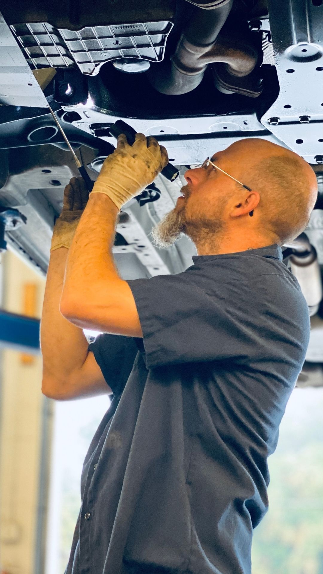 auto transmission repair at auto solutions of ormond beach employee is repairing a vehicle for car repairs